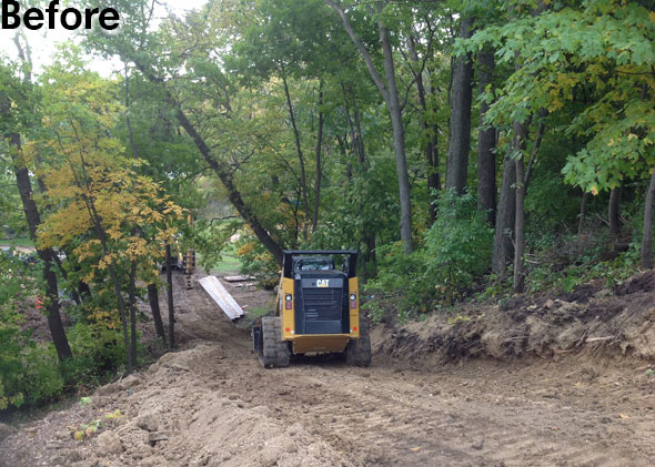 Using Skid steer to construct access road up the hillside