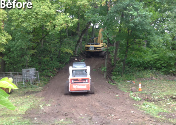 Excavator and Bobcat going up road on the hillside