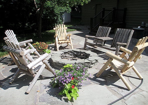 Backyard gathering place -- sitting chairs around the fire