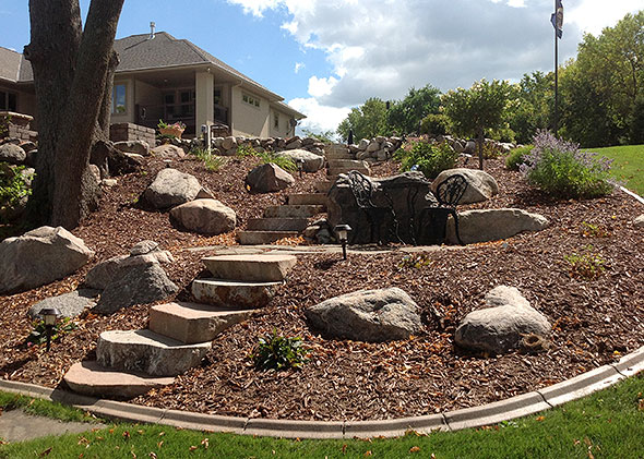 Steps through stonescaped lawn with mulch accents