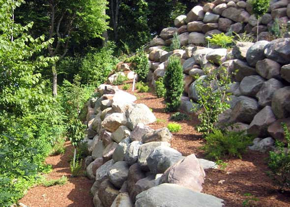 Stone walls added to steep terrain landscape