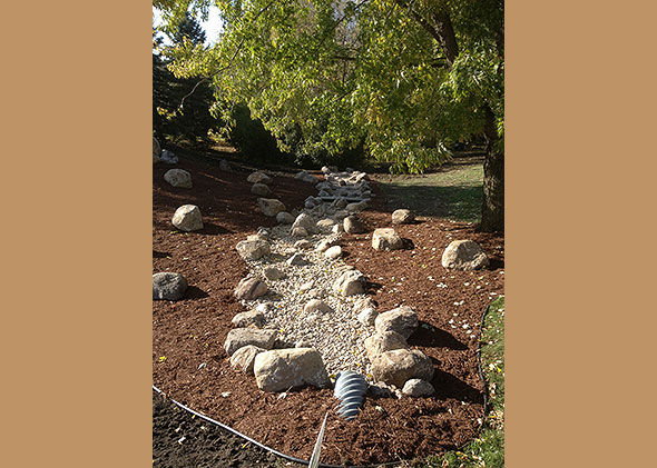 Garden stream over pebbles and rocks