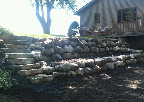 Retaining wall and steps made from boulders