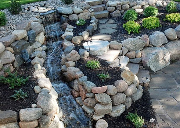 Boulder stonescape with running water feature